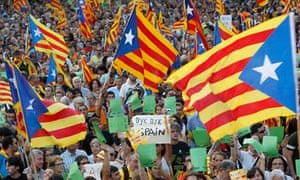 Marchers wave Catalonian nationalist flags on Catalan National Day in Barcelona