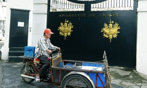 A Thai local resident passes the closed gate of the French embassy in Bangkok. The French foreign ministry announced that embassies, cultural centres and schools in around 20 countries would be closed on 21 September  as a precaution following the publication of cartoons of the prophet Muhammad by Charlie Hebdo.