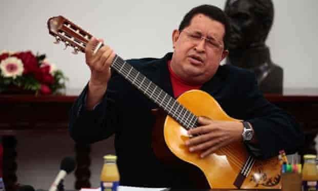 Venezuelan President Hugo Chavez seems a little lost in music, playing a guitar which was a gift from Mexican singer Vicente Fernandez, during a cabinet meeting at Miraflores Palace in Caracas.
