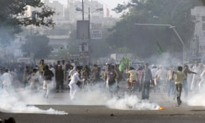 Pakistani Muslim demonstrators disperse after police fired tear gas during a protest against an anti-Islam film in Karachi.