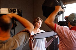 Milan Fashion Week: A model poses for photographers backstage before the Just Cavalli show