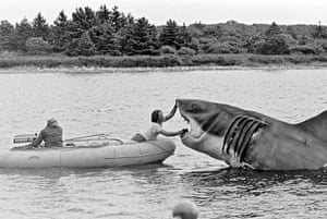 Jaws: Bob Mattey (steering boat) and Richie Helmer touch up the shark