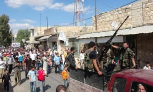 Members of the Free Syrian Army sit atop a truck in Maraa, near Aleppo