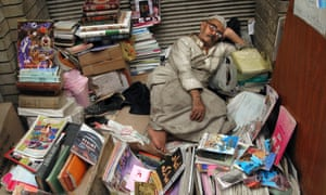 An Iraqi street vendor takes a break as he sells books on a street in central Baghdad, Iraq, Sunday, May 10, 2009. (AP Photo/Khalid Mohammed)