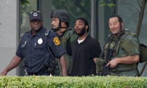 Police escort hostage taker Klein Michael Thaxton