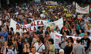 Protesters hold banners as they march during a demonstration against austerity measures in Madrid