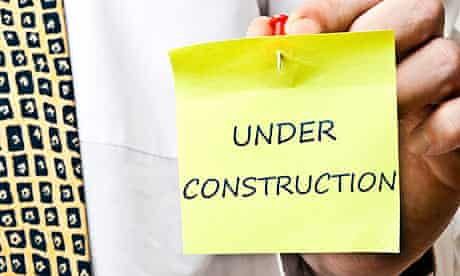 Under construction post it
