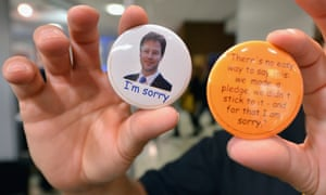 Badges quoting Nick Clegg's student fees pledge apology on sale at the Liberal Democrat conference in Brighton