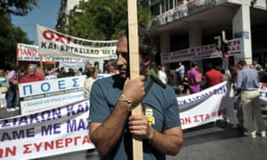 Striking journalists gather outside their union building in central Athens on September 24, 2012.