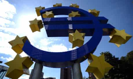 A giant euro logo stands in front of the headquarters of the European Central Bank