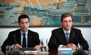 Portugal's Prime Minister Pedro Passos Coelho, right, and Finance Minister Vitor Gaspar pose for the media before a meeting with Portuguese leaders of national business and trade union confederations, in Lisbon, Monday, Sept. 24, 2012.