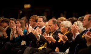 Danny Alexander, Nick Clegg and other senior Liberal Democrats applaud Cable's speech