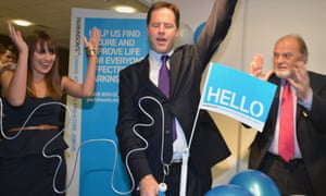 Nick Clegg plays a buzzer game as he tours the stalls