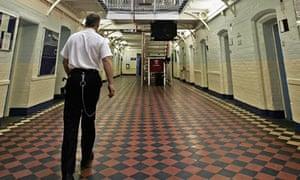 Prison officer inside a wing of HMP Norwich
