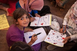 Syria Children: Children take part in drawing activities with Save The Children