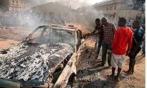 Wreckage of car bomb blast in Abuja after suspected Boko Haram attack