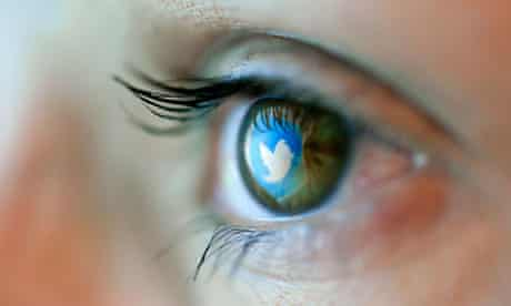 Reflection in an eye of the Twitter logo