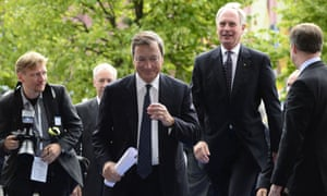 President of the European Central Bank (ECB) Mario Draghi (C) arrives to attend the annual meeting of the BDI (Federation of German Industries) in Berlin September 25, 2012.