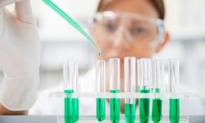 Scientist Filling Test Tubes In Lab
