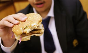 Teenager eating a burger