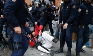 A protester screams as he is dragged away by police after police charged demonstrators outside the the Spanish parliament in Madrid, September 25, 2012.