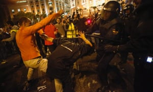 Riot police charge at demonstrators outside the Spanish parliament in Madrid.
