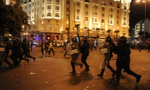 Police baton charge.  Photograph: DOMINIQUE FAGET/AFP/Getty Images