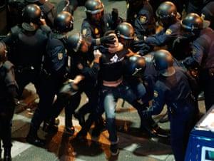 madrid: Madrid riot police and demonstrator