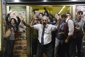 Madrid update: A man demonstrators to stop throwing stones at his restaurant