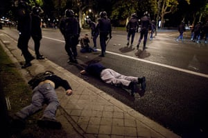 Madrid update: Protesters lay on the ground after riot police baton charged over them