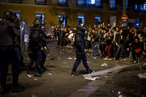 Madrid update: Demonstrators shout at riot policemen during a protest