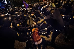 Madrid update: Spanish police in full riot gear kick a demonstrator during the march