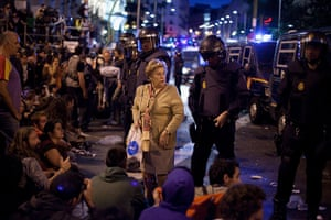 Madrid update: A woman in the middle of a demonstration surrounding the Spanish Parliament