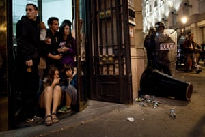 Madrid update: People take cover during clashes between protesters and riot police
