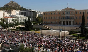 Supporters of the Greek Communist party march by the parliament during a 24-hour labour strike in Athens September 26, 2012.