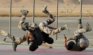 Saudi special forces show their skills during an opening ceremony of the new center for Special Elite Operations in the Dorma region.