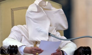 The wind plays is normal tricks on the Pope Benedict by blowing his collar into his face on during his weekly general audience in Saint-Peter's square at the Vatican.