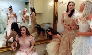 Debutantes Maria Austin, Amelia Simmons, Sophie Bonello, Zoe Rawson, and Georgina Riddle (L-R) attend a dress-fitting for Queen Charlotte's Ball in London. Queen Charlotte's Ball is a party for hand-picked group of girls from rich backgrounds, normally between 17 and 20 years.
