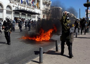 Greece protests: A molotov cocktail explodes beside riot police officers