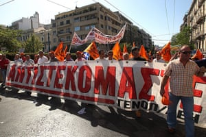 Greece protests: Workers hold a banner that reads 'resist' during a general strike