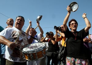 Greece protests: Demonstrators bang drums and pans in front of the Greek Parliament