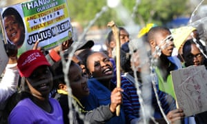 Supporters of South African Julius Malema, a former leader of the ANC Youth, demonstrate near the courthouse of Polokwane. Malema is charged with money laundering, fraud and corruption linked to public tenders, in a case that his supporters say is politically motivated.