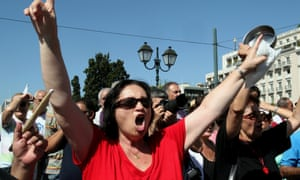 Demonstrators shout slogans in front of the Greek Parliament during a general strike in Athens.
