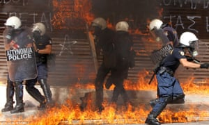 Riot police find themselves engulfed in flames during violent clashes demonstration in Athens, Greece.