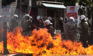 Riot policemen find themselves engulfed in flames during a general strike rally in Athens, Greece, 26 September 2012.