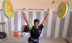 Iraq's first female national weightlifting team. Fifteen-year-old Hoda lifts weights at a gym in Sadr City, the Shiite-majority area of Baghdad.