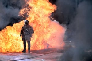 Greece protests update: A fire bomb explodes behind a riot police squad