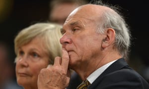 Vince Cable listens on as Jo Swinson addresses the conference.