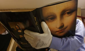 """David Feldman, Vice-President of the Mona Lisa Fondation, holds a book presenting the results of the research which demonstrate that there have always been two portraits of the Mona Lisa by Leonardo da Vinci, the """"Earlier Version"""", made 10 years earlier than the """"Joconde"""" that is displayed in Le Louvre in Paris."""