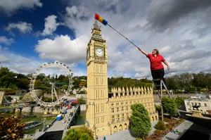 Legoland gallery: Model maker Paula Laughton reaches out to dust the tip of the model Big Ben